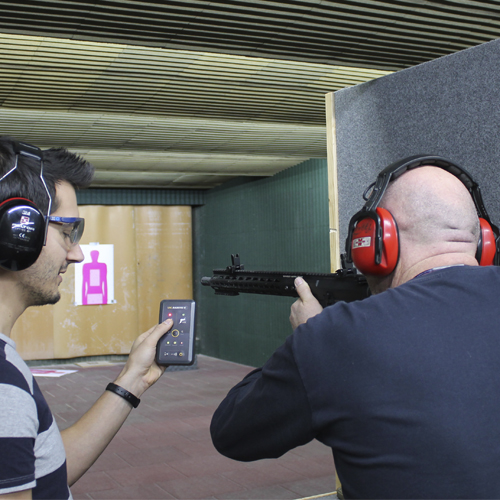 A photo for a Safe Shooting Range. There are 1 instructor and 1 shooter.