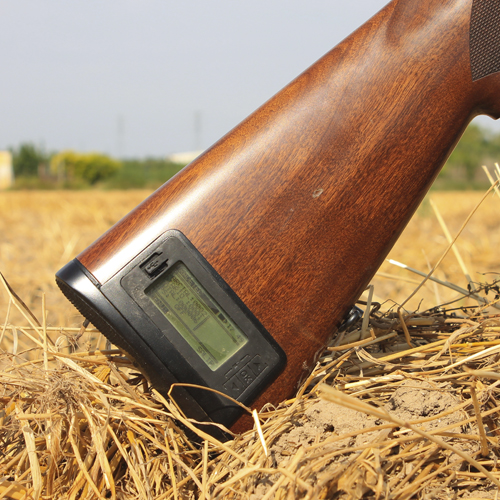 The system shotgun Butt stock by Radetec in a Shotgun. The photo is shooting in the countryside.